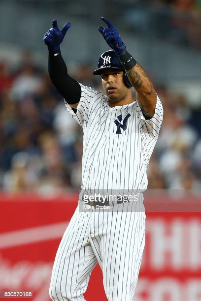 Aaron Hicks of the New York Yankees reacts after hitting a double in the third inning against the Boston Red Sox at Yankee Stadium on August 11 2017...
