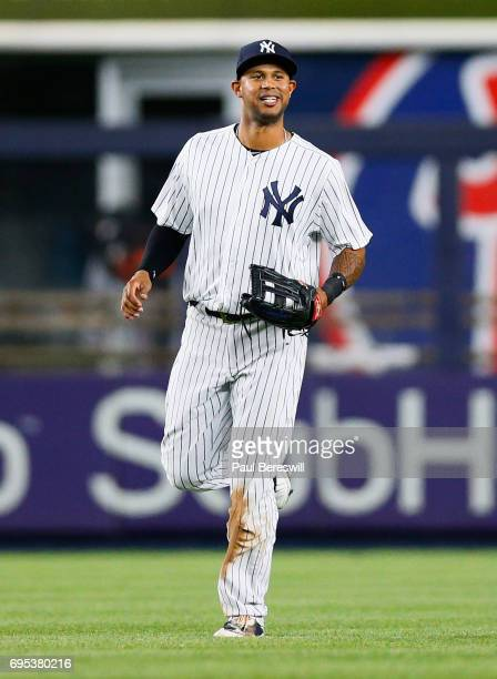 Aaron Hicks of the New York Yankees who hit two home runs in the game runs in from the outfield after the last out an MLB baseball game against the...