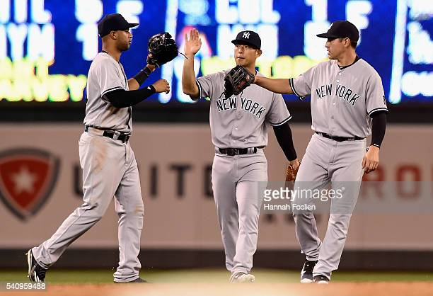 Aaron Hicks Rob Refsnyder and Jacoby Ellsbury of the New York Yankees celebrate a win of the game against the Minnesota Twins on June 17 2016 at...