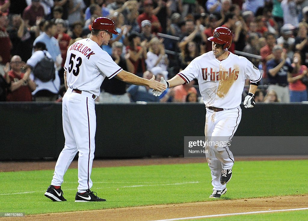 <a gi-track='captionPersonalityLinkClicked' href=/galleries/search?phrase=Aaron+Hill+-+Baseball+Player&family=editorial&specificpeople=239242 ng-click='$event.stopPropagation()'>Aaron Hill</a> #2 and third base coach Glenn Sherlock #53 of the Arizona Diamondbacks celebrate a two run home run in the fourth inning against the Philadelphia Phillies at Chase Field on April 25, 2014 in Phoenix, Arizona.