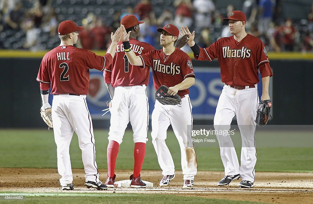 <a gi-track='captionPersonalityLinkClicked' href=/galleries/search?phrase=Aaron+Hill+-+Baseball+Player&family=editorial&specificpeople=239242 ng-click='$event.stopPropagation()'>Aaron Hill</a> #2, <a gi-track='captionPersonalityLinkClicked' href=/galleries/search?phrase=Didi+Gregorius&family=editorial&specificpeople=8945889 ng-click='$event.stopPropagation()'>Didi Gregorius</a> #1, Ender Inciarte #5 (C) and <a gi-track='captionPersonalityLinkClicked' href=/galleries/search?phrase=Mark+Trumbo&family=editorial&specificpeople=4921667 ng-click='$event.stopPropagation()'>Mark Trumbo</a> #15 of the Arizona Diamondbacks celebrate a 6-2 victory against the Colorado Rockies during a MLB game at Chase Field on August 31, 2014 in Phoenix, Arizona.