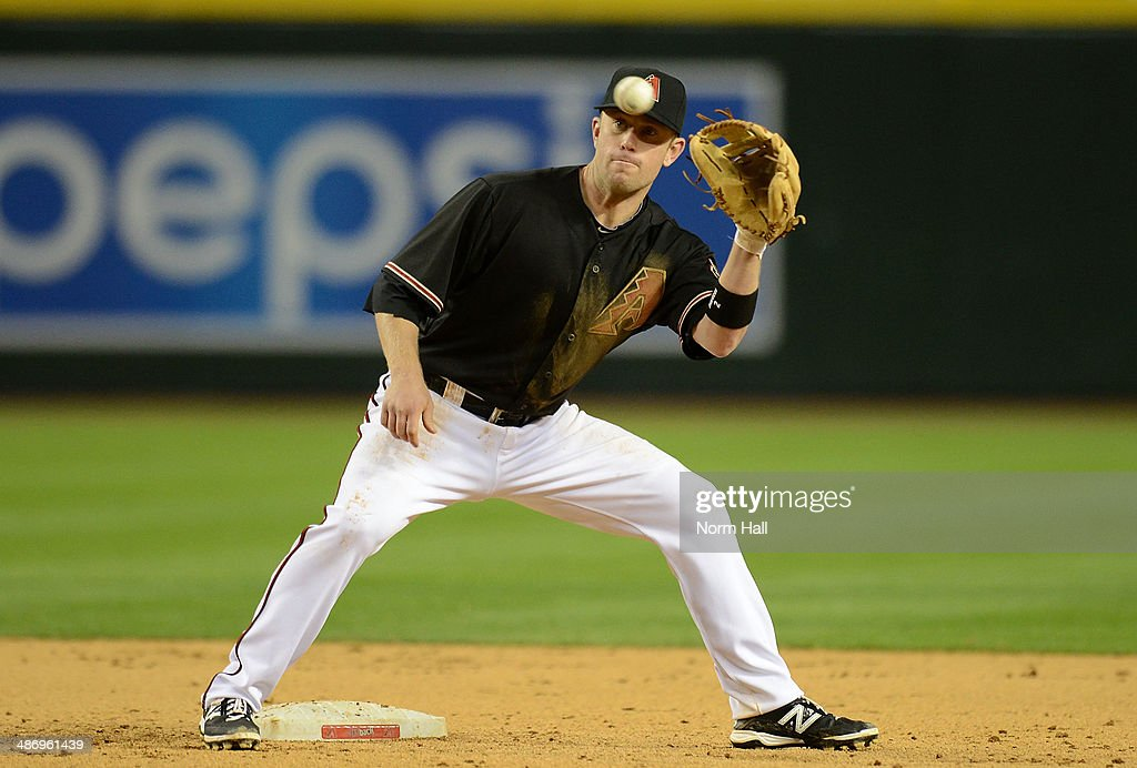 <a gi-track='captionPersonalityLinkClicked' href=/galleries/search?phrase=Aaron+Hill+-+Baseball+Player&family=editorial&specificpeople=239242 ng-click='$event.stopPropagation()'>Aaron Hill</a> #2 of the Arizona Diamondbacks catches a throw while covering second base against the Philadelphia Phillies at Chase Field on April 26, 2014 in Phoenix, Arizona.