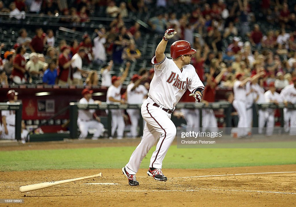 Aaron Hill #2 of the Arizona Diamondbacks celebrates after hitting a walk off three run home run against the Colorado Rockies during the ninth inning of the MLB game at Chase Field on October 2, 2012 in Phoenix, Arizona. The Diamondbacks defeated the Rockies 5-3.
