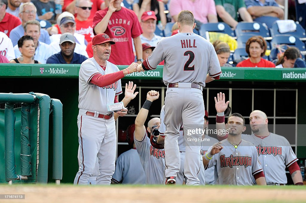<a gi-track='captionPersonalityLinkClicked' href=/galleries/search?phrase=Aaron+Hill+-+Baseball+Player&family=editorial&specificpeople=239242 ng-click='$event.stopPropagation()'>Aaron Hill</a> #2 of the Arizona Diamondbacks celebrates with manager Kirk Gibson #23 after hitting a home run in the sixth inning against the Washington Nationals at Nationals Park on June 27, 2013 in Washington, DC.
