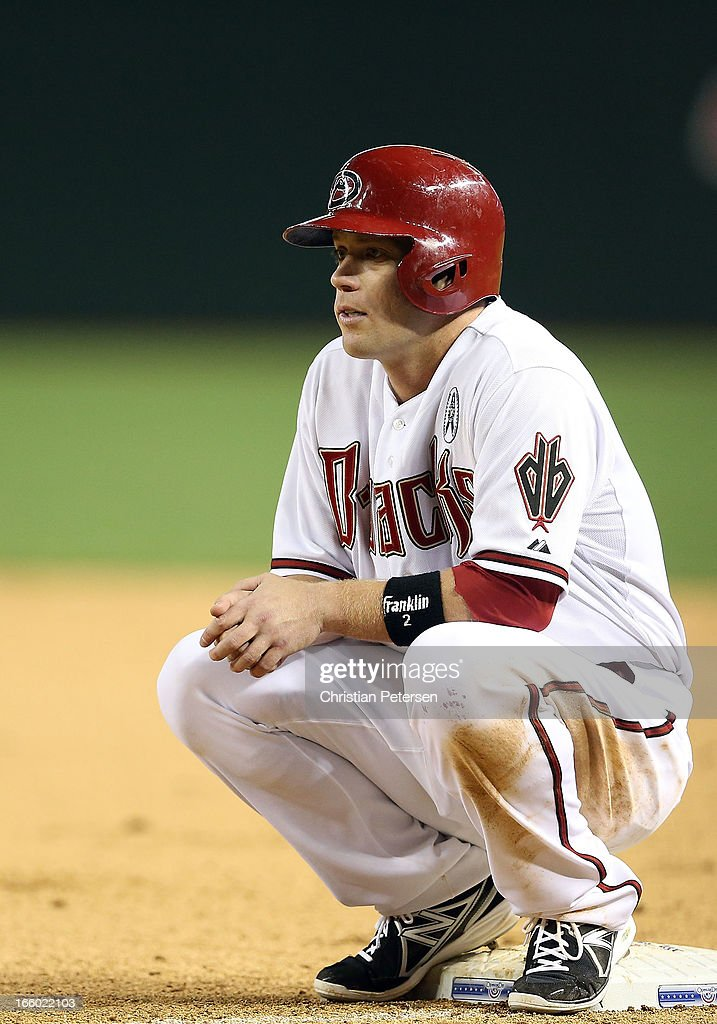 <a gi-track='captionPersonalityLinkClicked' href=/galleries/search?phrase=Aaron+Hill&family=editorial&specificpeople=239242 ng-click='$event.stopPropagation()'>Aaron Hill</a> #2 of the Arizona Diamondbacks during the MLB Opening Day game against the St. Louis Cardinals at Chase Field on April 1, 2013 in Phoenix, Arizona. The Diamondbacks defeated the Cardinals 6-2.