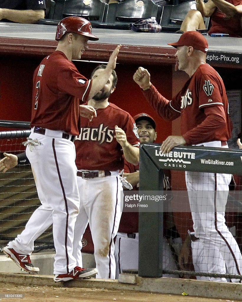 <a gi-track='captionPersonalityLinkClicked' href=/galleries/search?phrase=Aaron+Hill+-+Baseball+Player&family=editorial&specificpeople=239242 ng-click='$event.stopPropagation()'>Aaron Hill</a> #2 of the Arizona Diamondbacks is congratulated by manager <a gi-track='captionPersonalityLinkClicked' href=/galleries/search?phrase=Kirk+Gibson&family=editorial&specificpeople=207042 ng-click='$event.stopPropagation()'>Kirk Gibson</a> #23 after scoring on a Martin Prado double in the eighth inning against the Los Angeles Dodgers during a MLB game at Chase Field on September 18, 2013 in Phoenix, Arizona.