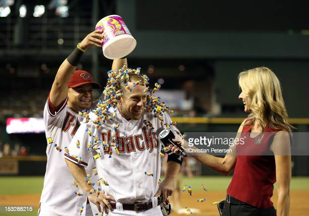 Aaron Hill of the Arizona Diamondbacks is covered in bubble gum by Gerardo Parra as he receives his post game interview from television personality...