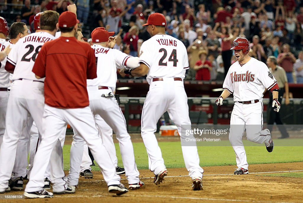 Aaron Hill #2 of the Arizona Diamondbacks is greeted by teammates at home plate after hitting a walk off three-run home run against the Colorado Rockies during the ninth inning of the MLB game at Chase Field on October 2, 2012 in Phoenix, Arizona. The Diamondbacks defeated the Rockies 5-3.