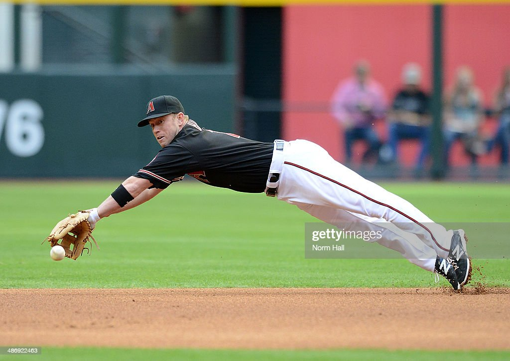 <a gi-track='captionPersonalityLinkClicked' href=/galleries/search?phrase=Aaron+Hill+-+Baseball+Player&family=editorial&specificpeople=239242 ng-click='$event.stopPropagation()'>Aaron Hill</a> #2 of the Arizona Diamondbacks makes a diving attempt at a ground ball in the first inning against the Philadelphia Phillies at Chase Field on April 26, 2014 in Phoenix, Arizona.