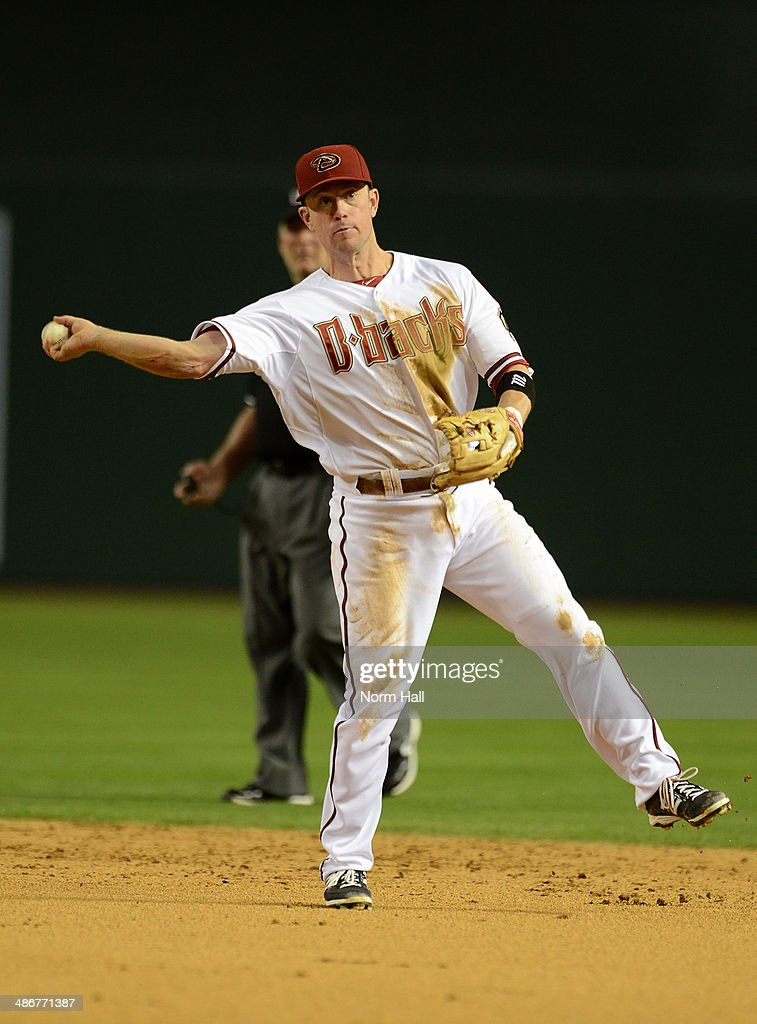 <a gi-track='captionPersonalityLinkClicked' href=/galleries/search?phrase=Aaron+Hill+-+Baseball+Player&family=editorial&specificpeople=239242 ng-click='$event.stopPropagation()'>Aaron Hill</a> #2 of the Arizona Diamondbacks makes a running throw to first base against the Philadelphia Phillies at Chase Field on April 25, 2014 in Phoenix, Arizona. Arizona won 5-4.