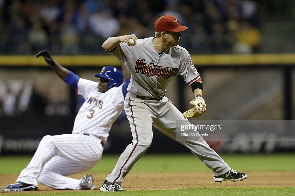 <a gi-track='captionPersonalityLinkClicked' href=/galleries/search?phrase=Aaron+Hill&family=editorial&specificpeople=239242 ng-click='$event.stopPropagation()'>Aaron Hill</a> #2 of the Arizona Diamondbacks makes the throw to first base for the out as Yuniesky Betancourt #3 the Milwaukee Brewers slides into second base in the bottom of the seventh inning at Miller Park on April 5, 2013 in Milwaukee, Wisconsin.