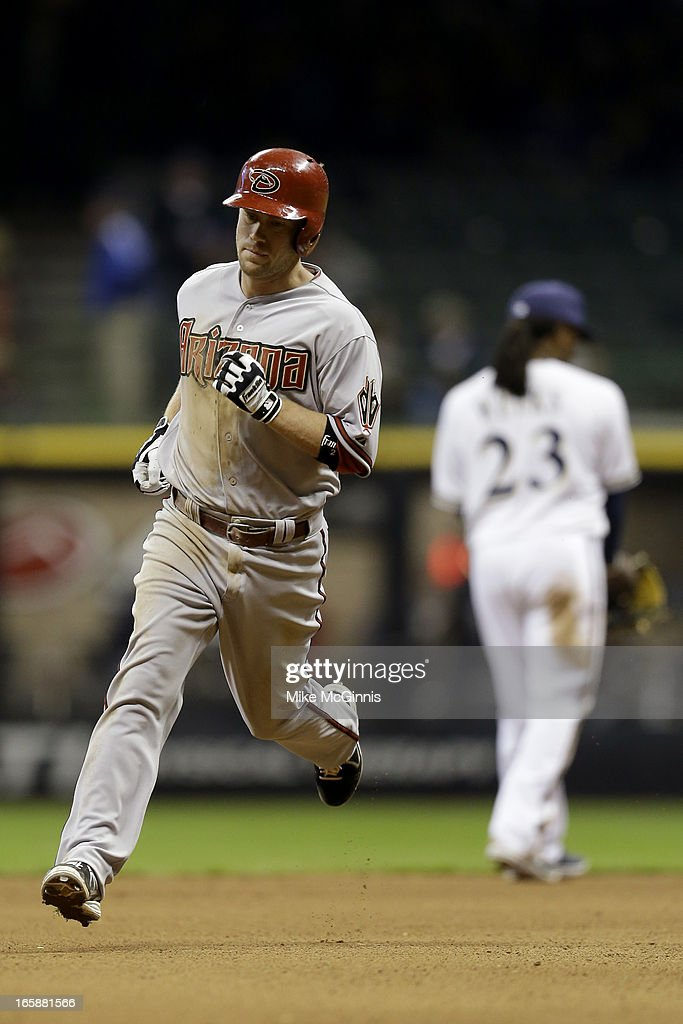 Aaron Hill #2 of the Arizona Diamondbacks runs the bases after hitting a solo home run in the top of the eighth inning against the Milwaukee Brewers at Miller Park on April 6, 2013 in Milwaukee, Wisconsin.