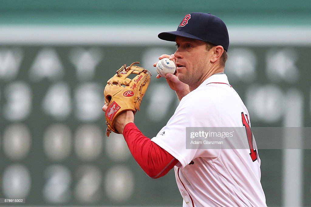 Aaron Hill of the Boston Red Sox makes a throw to first base in the seventh inning of the game against the Tampa Bay Rays at Fenway Park on July 9...