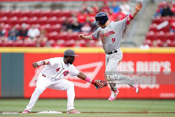 Aaron Hill of the Milwaukee Brewers is tagged out trying to steal second base by Brandon Phillips of the Cincinnati Reds in the eighth inning at...