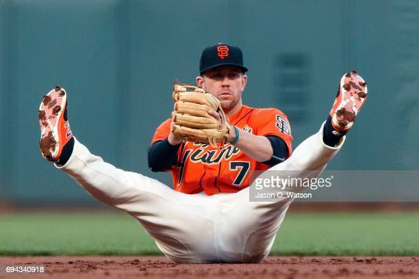 Aaron Hill of the San Francisco Giants catches a line drive hit off the bat of Max Kepler of the Minnesota Twins during the second inning at ATT Park...