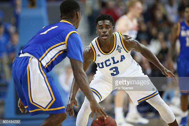 Aaron Holiday of the UCLA Bruins defends against Jamaya Burr of the McNeese State Cowboys in the second period at Pauley Pavilion on December 22 2015...