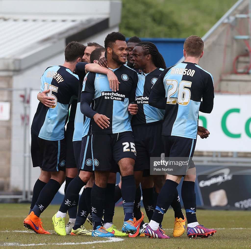 Aaron Holloway (C) of Wycombe Wanderers is congratulated by team mates after scoring his side's 1st goal during the Sky Bet League Two match between Northampton Town and Wycombe Wanderers at Sixfields Stadium on May 2, 2015 in Northampton, England.