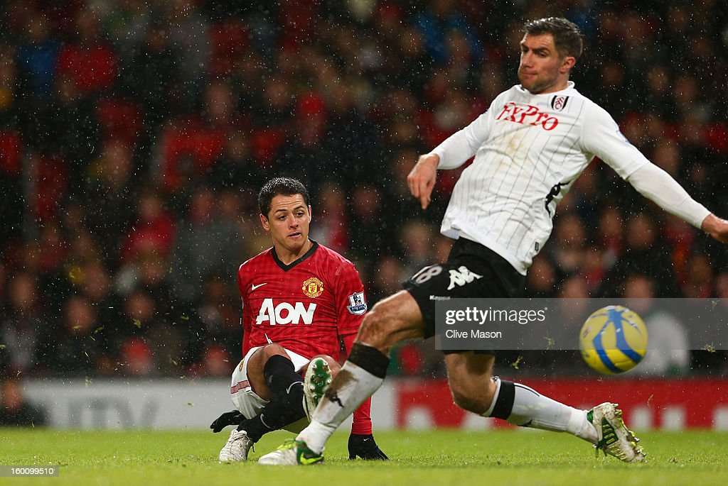 <a gi-track='captionPersonalityLinkClicked' href=/galleries/search?phrase=Aaron+Hughes&family=editorial&specificpeople=217734 ng-click='$event.stopPropagation()'>Aaron Hughes</a> of Fulham is unable to stop Javier Hernandez of Manchester United scoring his team's fourth goal during the FA Cup with Budweiser Fourth Round match between Manchester United and Fulham at Old Trafford on January 26, 2013 in Manchester, England.