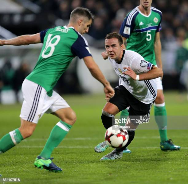 Aaron Hughes of Northern Ireland Mario Goetze of Germany battle for the balll during the FIFA 2018 World Cup Qualifier between Germany and Northern...