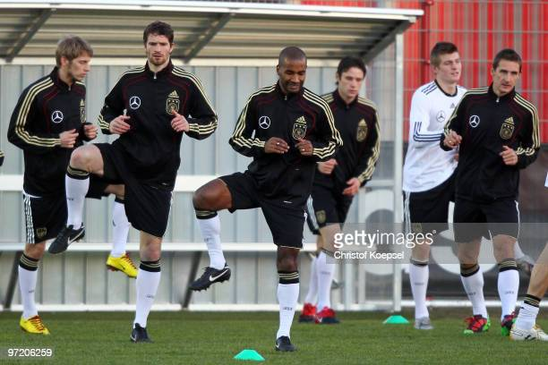 Aaron Hunt Arne Friedrich Cacau Christian Traesch Toni Kroos and Miroslav Klose stretch during the training session of the German National team at...