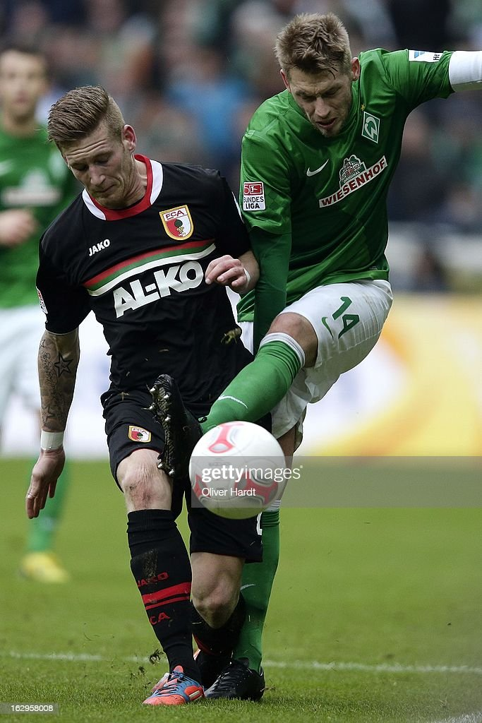 Aaron Hunt (R) of Bremen and Andre Hahn (L) of Augsburg battle for the ball during the Bundesliga match between SV Werder Bremen and FC Augsburg at Weser Stadium on March 2, 2013 in Bremen, Germany.