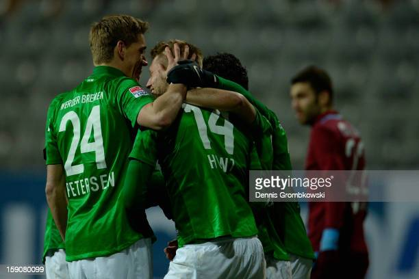 Aaron Hunt of Bremen celebrates with teammates during a friendly match between Werder Bremen and Trabzonspor at day three of the Werder Bremen...