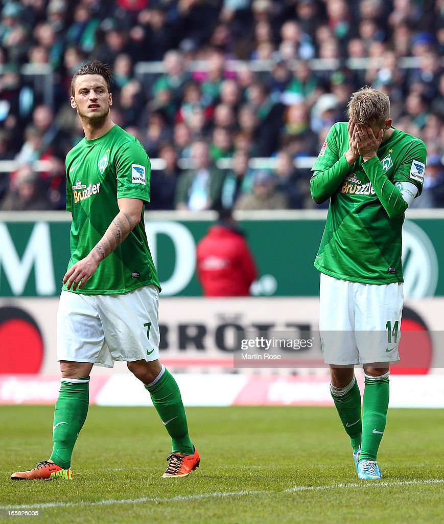 Aaron Hunt (R) of Bremen reacts during the Bundesliga match between Werder Bremen and FC Schalke 04 at Weser Stadium on April 6, 2013 in Bremen, Germany.