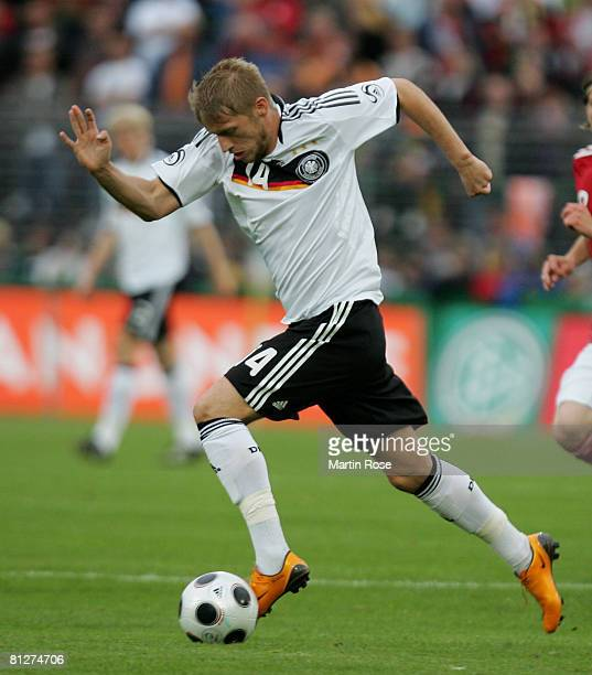 Aaron Hunt of Germany runs with the ball during the U21 international friendly match between Germany and Denmark at the Lohmuehlen stadium on May 28...