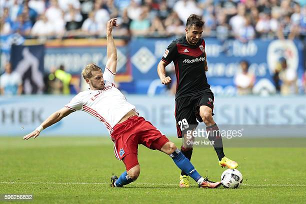 Aaron Hunt of Hamburg and Markus Suttner of Ingoldstadt compete for the ball during the Bundesliga match between Hamburger SV and FC Ingolstadt 04 at...