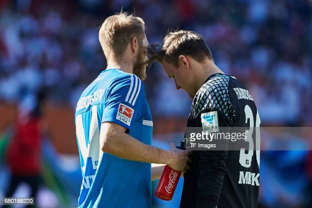 Aaron Hunt of Hamburg and Tom Mickel of Hamburg looks dejected during the Bundesliga match between FC Augsburg and Hamburger SV at WWK Arena on April...