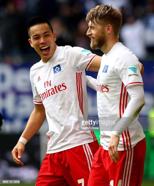 Aaron Hunt of Hamburg celebrate with his team mate Bobby Wood after scoring the 2nd goal during the Bundesliga match between Hamburger SV and TSG...
