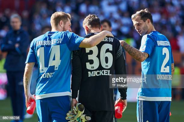 Aaron Hunt of Hamburg Dennis Diekmeier of Hamburg and Tom Mickel of Hamburg looks dejected during the Bundesliga match between FC Augsburg and...