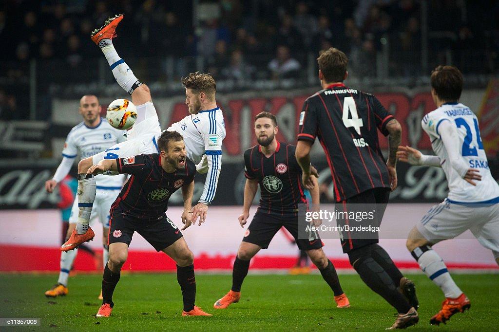 Aaron Hunt of Hamburg falls over Szabolcs Huszti of Frankfurt during the Bundesliga match between Eintracht Frankfurt and Hamburger SV at...