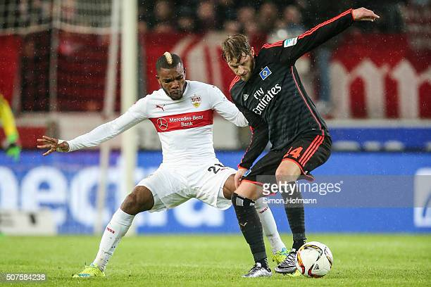 Aaron Hunt of Hamburg is challenged by Serey Die of Stuttgart during the Bundesliga match between VfB Stuttgart and Hamburger SV at MercedesBenz...