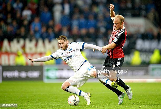 Aaron Hunt of Hamburg is challenged by Tobias Levels of Ingolstadt during the Bundesliga match between FC Ingolstadt and Hamburger SV at Audi...