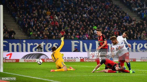 Aaron Hunt of Hamburg scores his goal during the Bundesliga match between Hamburger SV and SC Freiburg at Volksparkstadion on February 18 2017 in...
