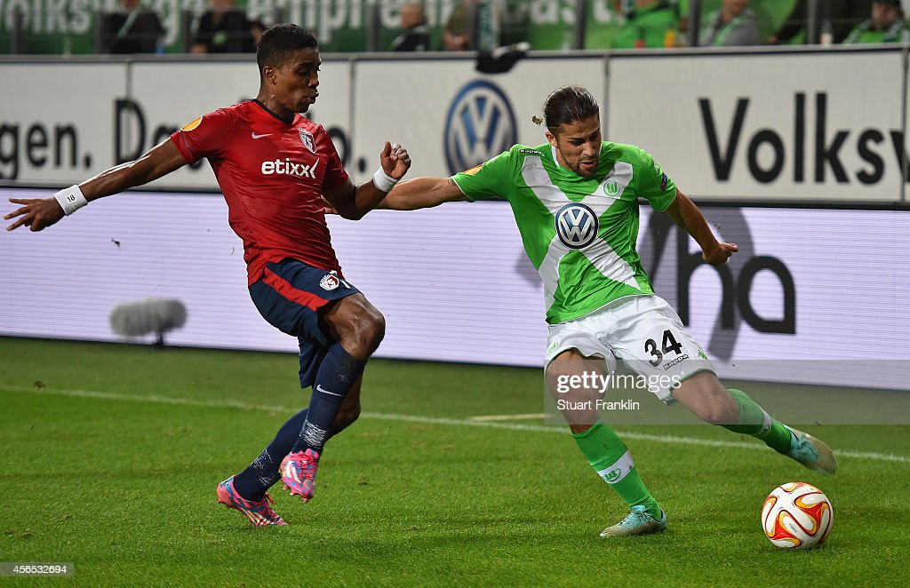 Aaron Hunt of Wolfsburg is challenged by Franck Beria of Lille during the UEFA Europa League match between VfL Wolfsburg and LOSC Lille at the Volkswagen Arena on October 2, 2014 in Wolfsburg, Germany.