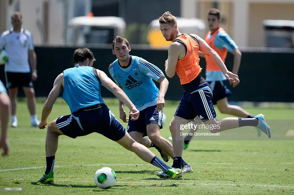Aaron Hunt passes the ball during a training session at Barry University on May 24, 2013 in Miami, Florida.