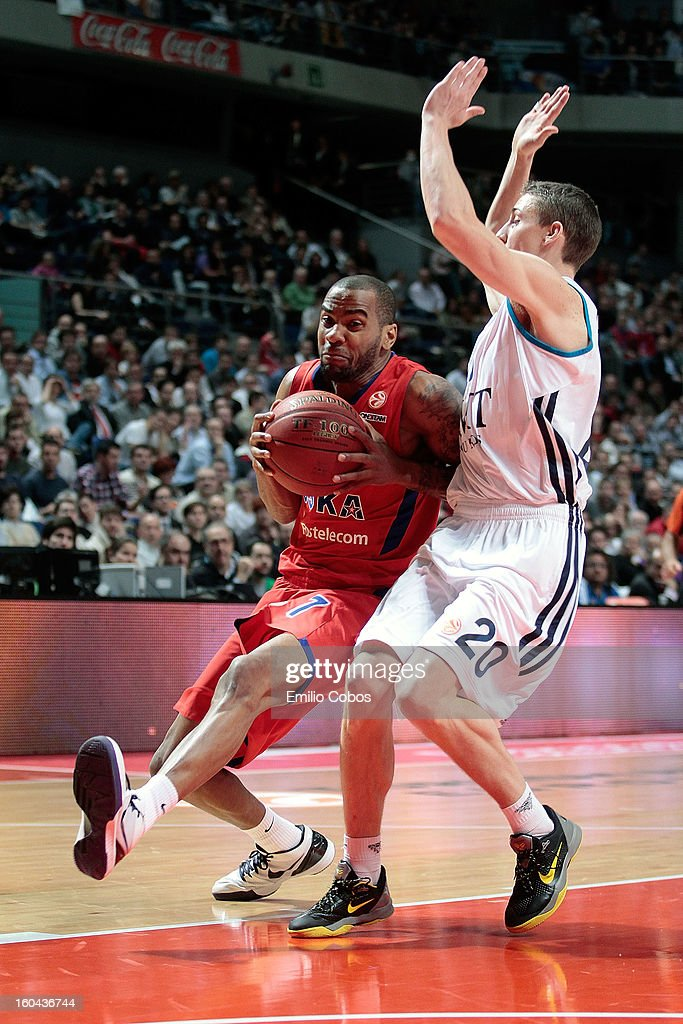 Aaron Jackson, #7 of CSKA Moscow competes with Jaycee Carroll, #20 of Real Madrid during the 2012-2013 Turkish Airlines Euroleague Top 16 Date 6 between Real Madrid v CSKA Moscow at Palacio Deportes Comunidad de Madrid on January 31, 2013 in Madrid, Spain.