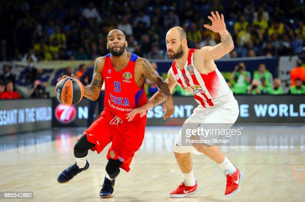 Aaron Jackson #9 of CSKA Moscow competes with Vassilis Spanoulis #7 of Olympiacos Piraeus during the Turkish Airlines EuroLeague Final Four Semifinal...