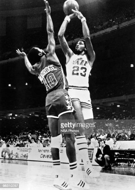 Aaron James of the New Orleans Jazz shoots against Bob Dandridge of the Milwaukee Bucks during a game played in 1975 in New Orleans Louisiana NOTE TO...