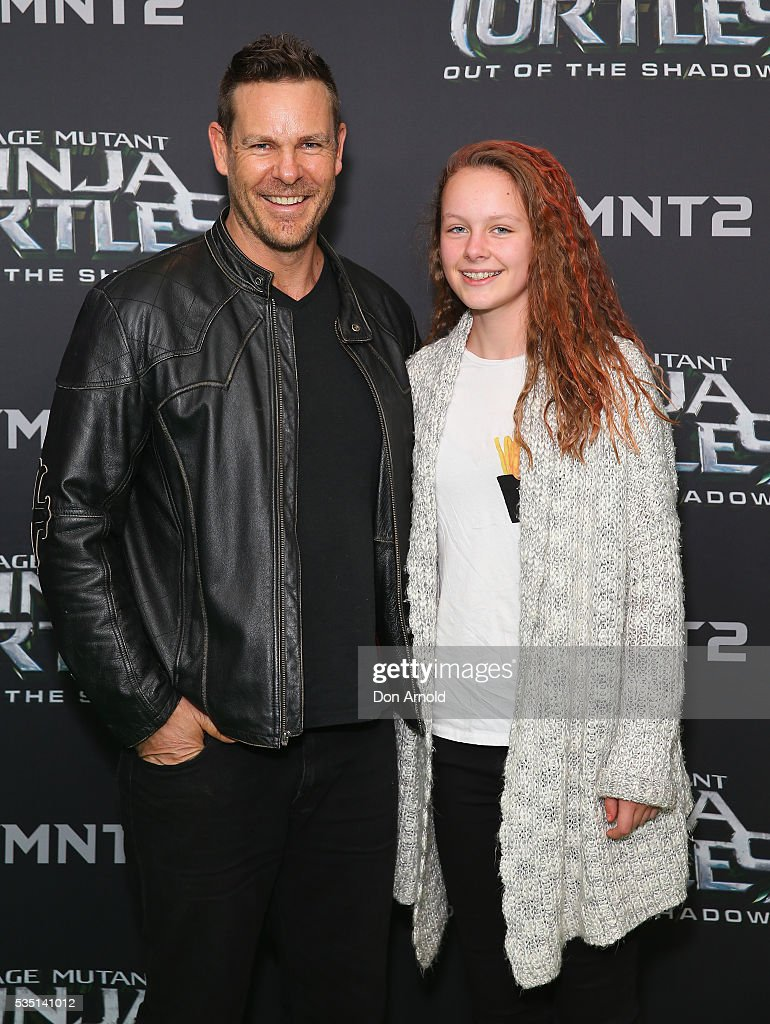 Aaron Jeffrey and guest attend the Australian Premiere of Teenage Mutant Ninja Turtles 2 at Event Cinemas George Street on May 29, 2016 in Sydney, Australia.