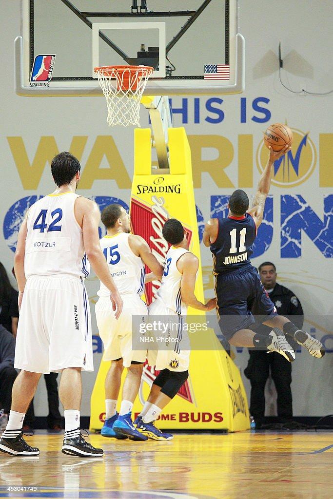 Aaron Johnson #11 of the Bakersfield Jam shoots a shot against the Santa Cruz Warriors on November 30, 2013 at Kaiser Permanente Arena in Santa Cruz, California.