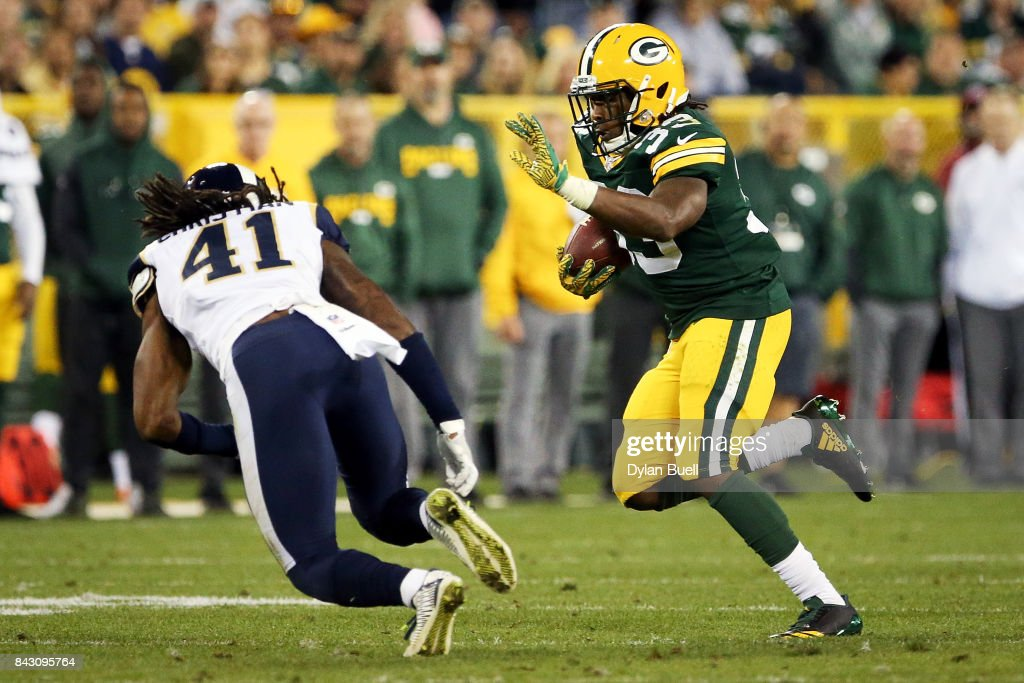 5d5b5e76b ... Aaron Jones 33 of the Green Bay Packers runs with the ball while being  chased ...