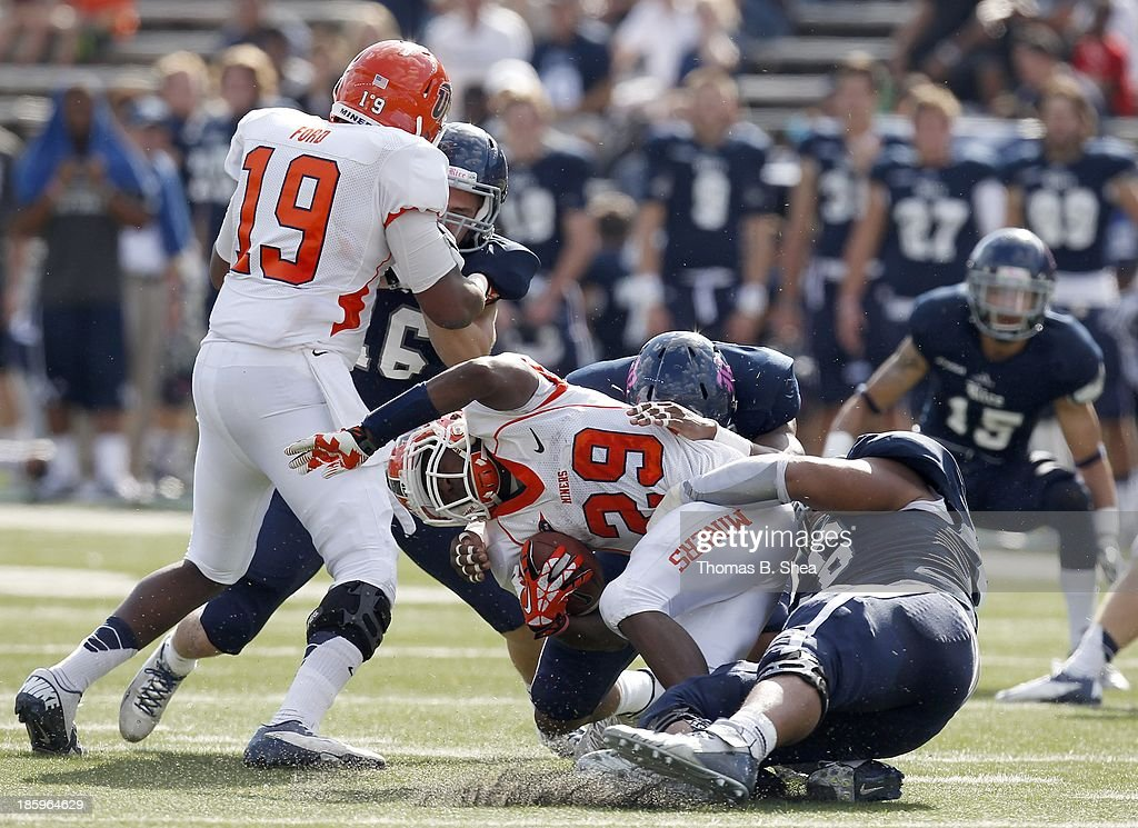 Aaron Jones #29 of the UTEP Miners is tackled by Christian Covington #56 of the Rice Owls for a loss on October 26, 2013 at Rice Stadium in Houston, Texas. Rice won 45 to 7.