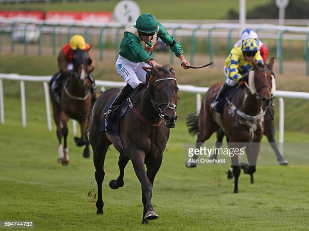 Aaron Jones riding Roly Tricks win The Danny Traynor memorial Handicap Stakes at Lingfield Park on August 24 2016 in Lingfield England