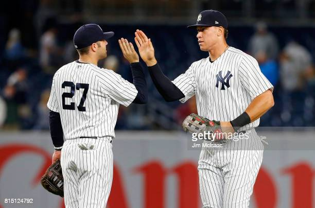 Aaron Judge and Austin Romine of the New York Yankees in action against the Boston Red Sox at Yankee Stadium on June 8 2017 in the Bronx borough of...