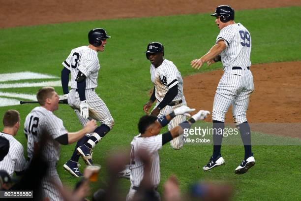 Aaron Judge and Didi Gregorius of the New York Yankees celebrate after scoring on a tworun goahead double by Gary Sanchez during the eighth inning...