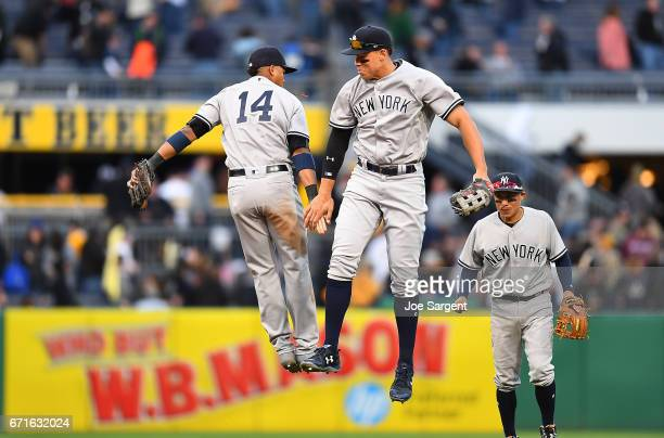 Aaron Judge celebrates with Starlin Castro of the New York Yankees after a 115 win over the Pittsburgh Pirates at PNC Park on April 22 2017 in...