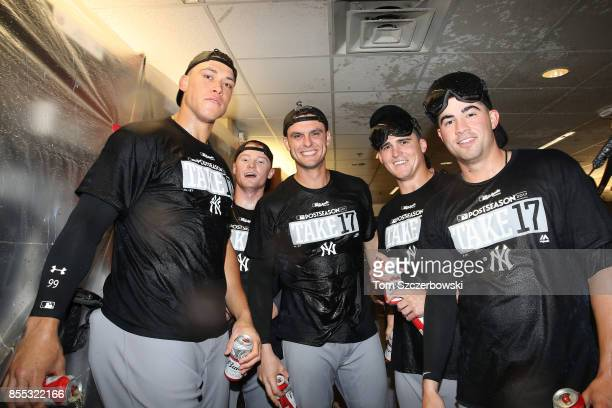 Aaron Judge of the New York Yankees and Clint Frazier and Greg Bird and Tyler Austin and Tyler Wade pose as they celebrate their playoffclinching...